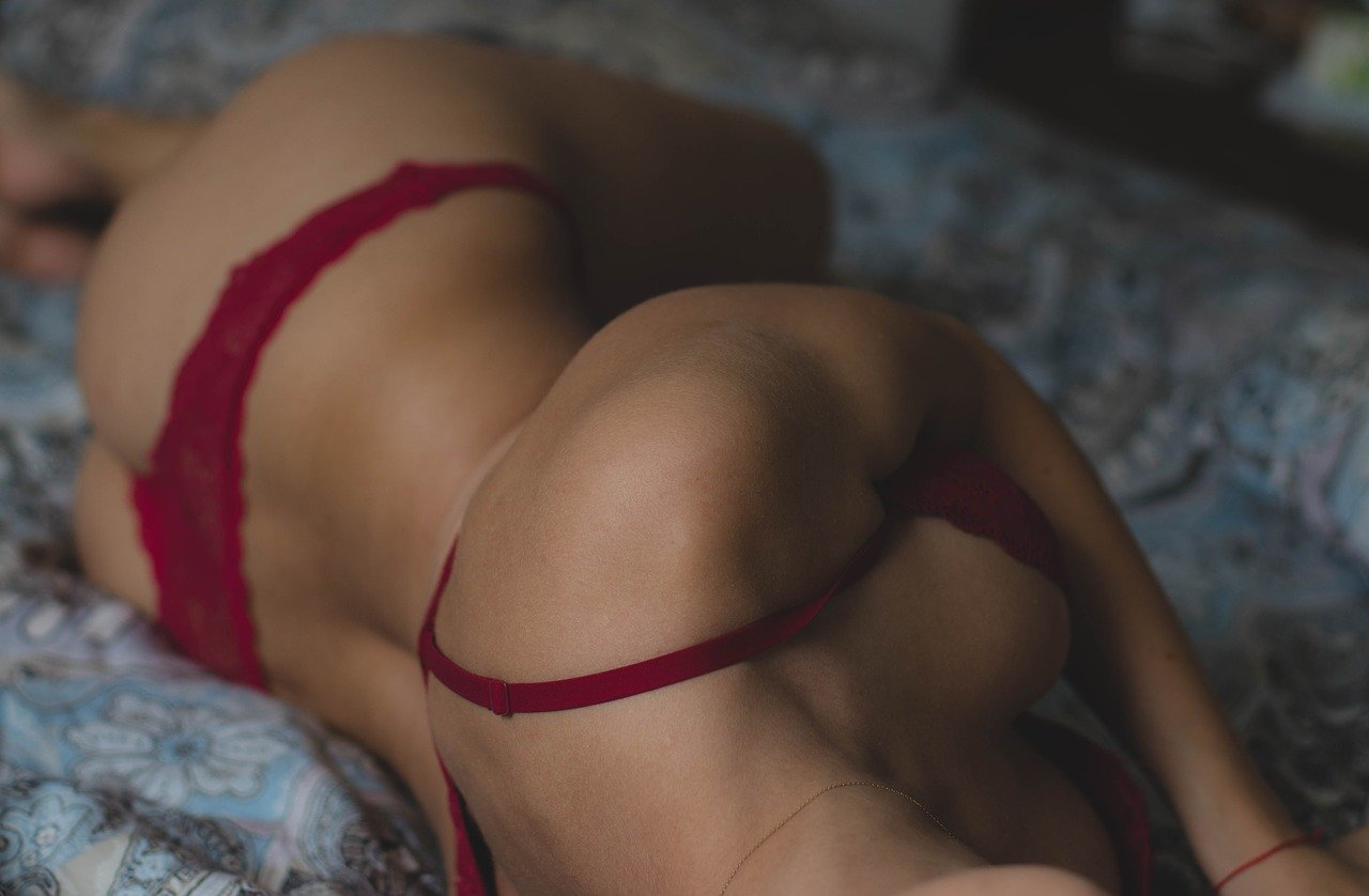 Image of a girl using lingerie in bed